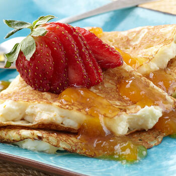 Cream Cheese Filled Crepes with Mango Peach Sauce